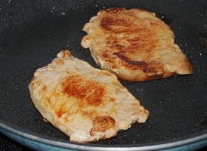 Brown pork chops on both sides.