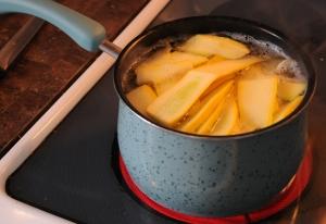 Boil strips of zucchini/summer squash.