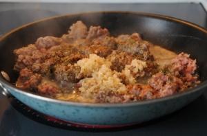 Brown turkey and garlic in a skillet.