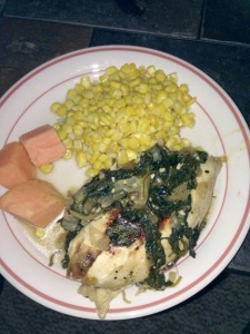 Chicken sauteed with onion, garlic, wine and spinach with sides of sweet potato and corn.